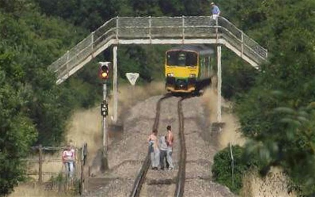 Teens play chicken with train in UK.