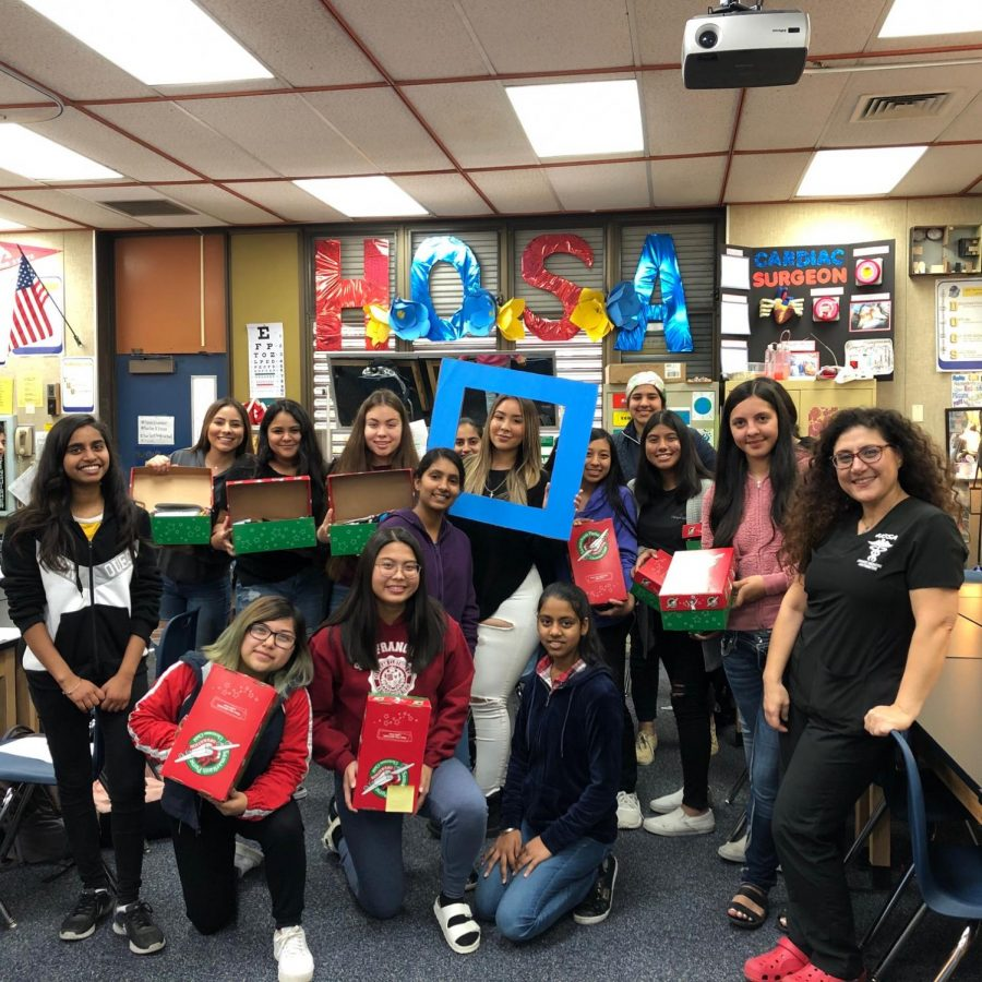 HOSA 2019-2020 get ready to give gifts to the needy.